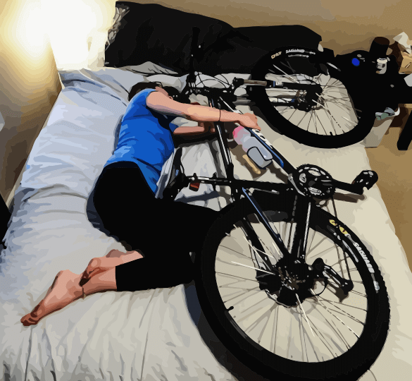 Woman with Bike in Bed