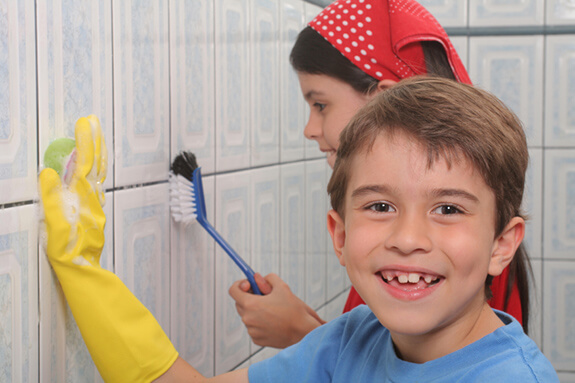 Two Kids Cleaning the Bathroom