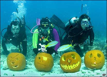 Three Scuba Divers and Four Pumpkins